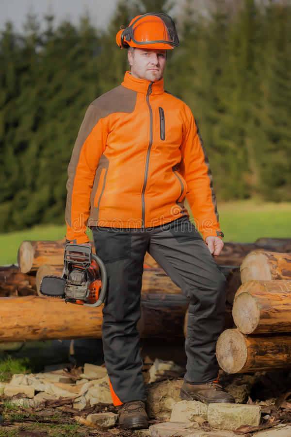 Man with chainsaw. A man with chainsaw outdoor stock photography