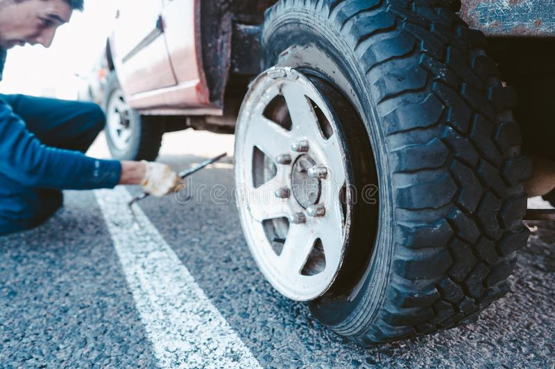 Man change the wheel manually on a 4x4 off road truck stock photos