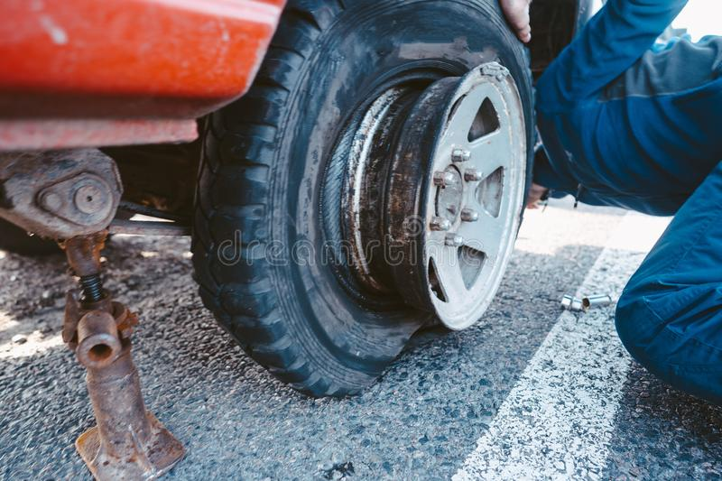 Man change the wheel manually on a 4x4 off road truck royalty free stock photos