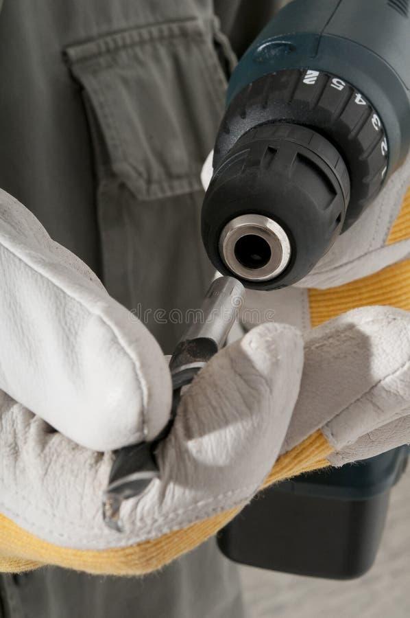 Free Man Changing Drill Bit Royalty Free Stock Image - 16465526