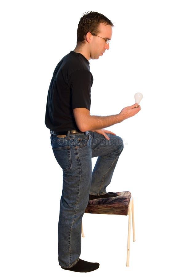 Man Changing Lightbulb stock photo