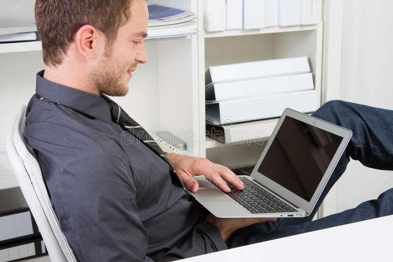 Man chats during working hours stock image