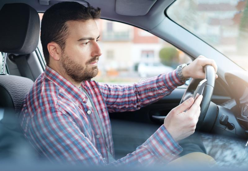Man chatting on the mobile phone while driving stock photos