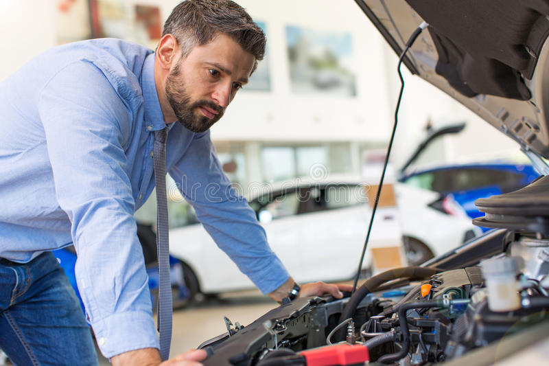 Man checking car engine royalty free stock photography
