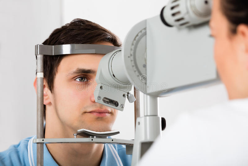 Man Checking Eyesight In Clinic royalty free stock photo