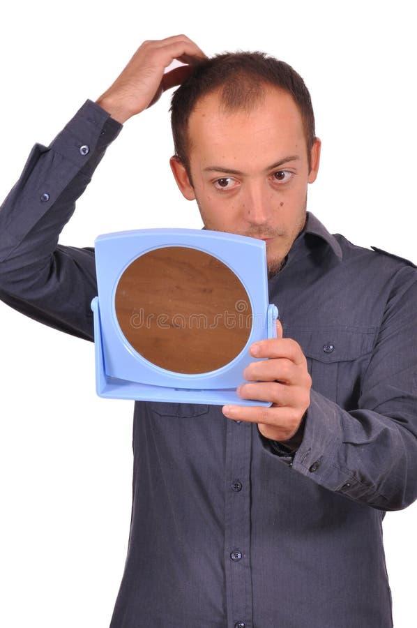 Free Man Checking His Hair Loss In The Mirror Royalty Free Stock Photos - 34522308