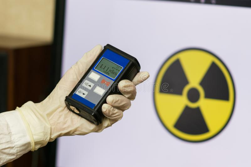 Man checking radiation with geiger counter. Concept - radiation hazard, pollution royalty free stock images