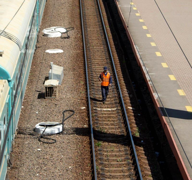 Man checking railway line royalty free stock photos