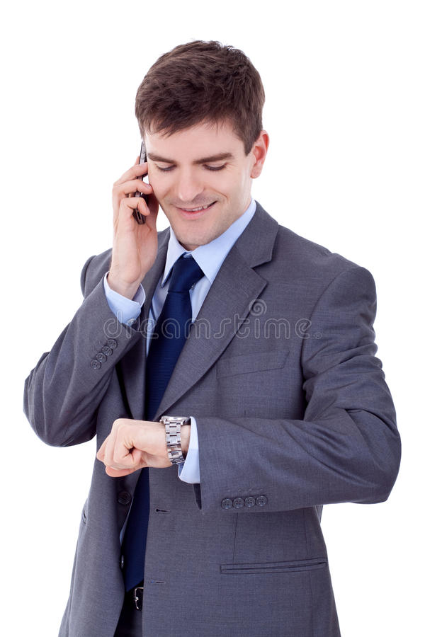 Download Man Checking Time While Speaking On Cellphone Stock Photo - Image: 18593110