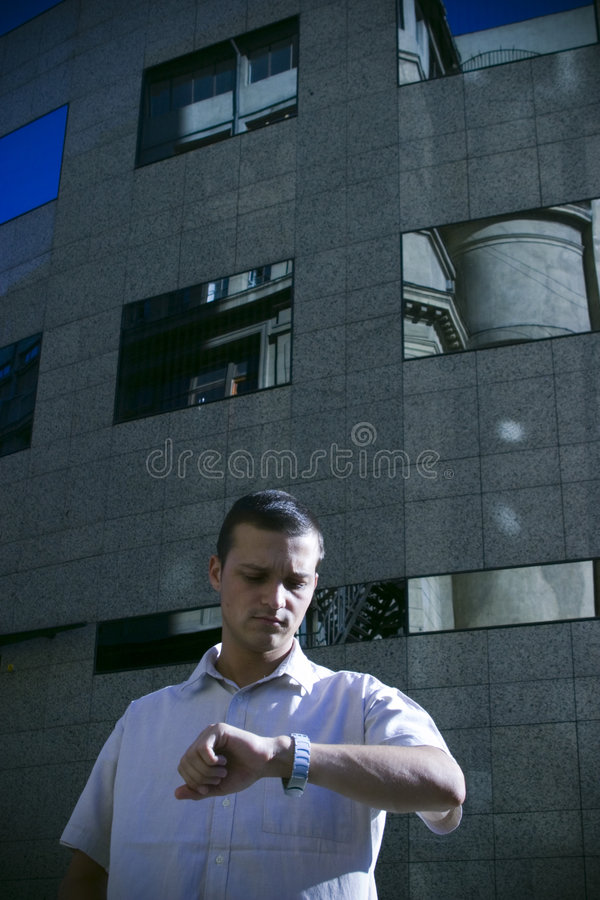 Download Man checking watch stock photo. Image of office, business - 1258422