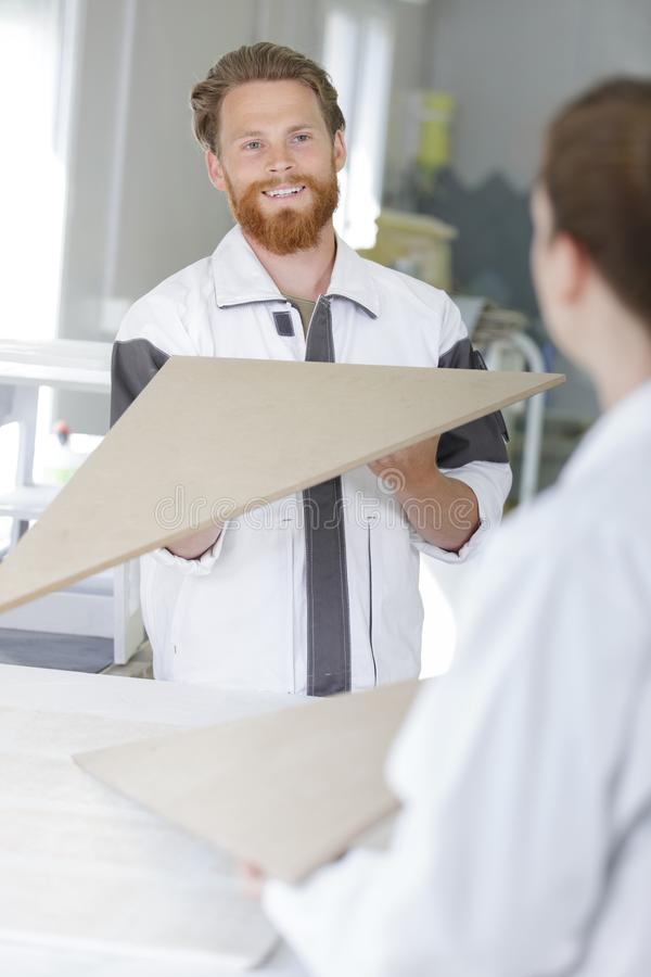 Man checks evenness paint application royalty free stock photo