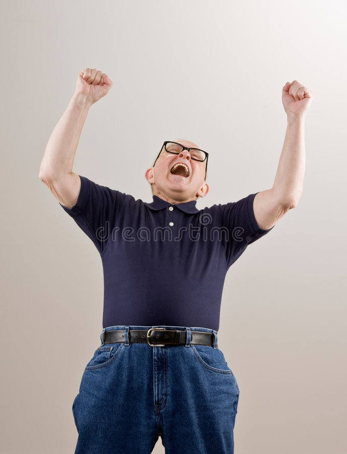 Man cheering and celebrating his success