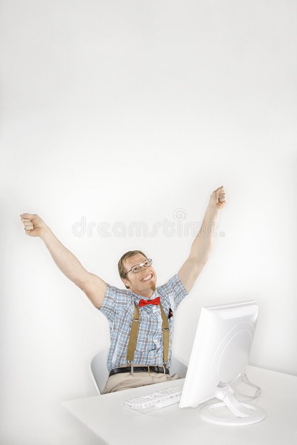 Man cheering in front of computer. royalty free stock photo