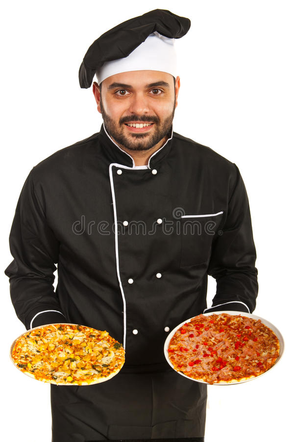 Man chef serving pizza. Chef man in black uniform serving pizza isolated on white background stock images