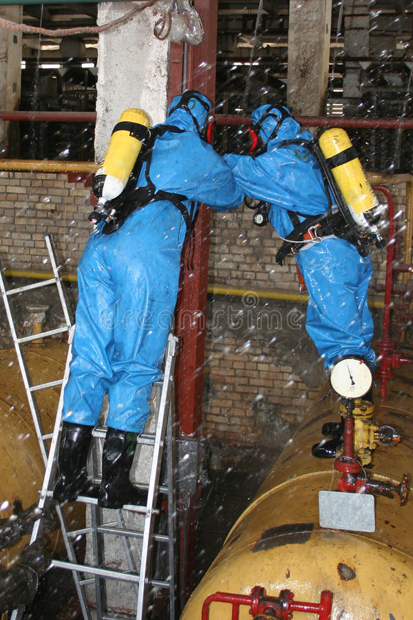Man in chemical protection suit. Carrying out the decontamination area royalty free stock image