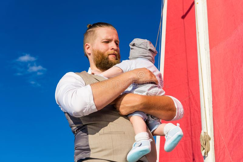 Man with a child on the background of the sail royalty free stock photos