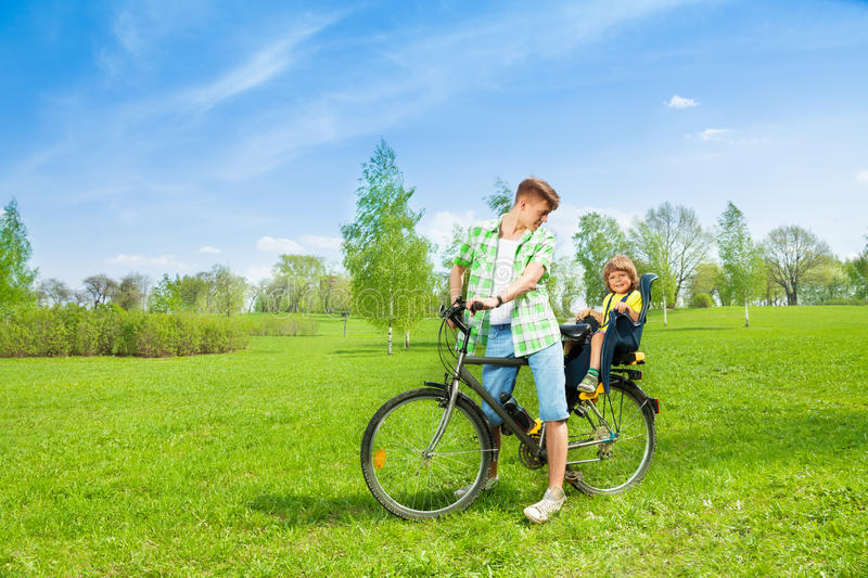 Man with child on the bike stock photography