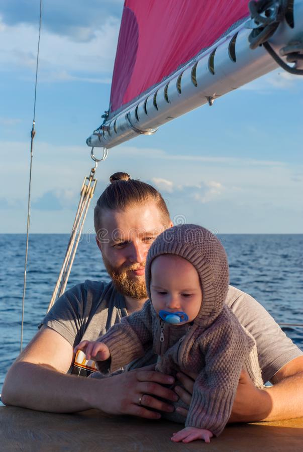 Man with a child on a sailing ship royalty free stock image