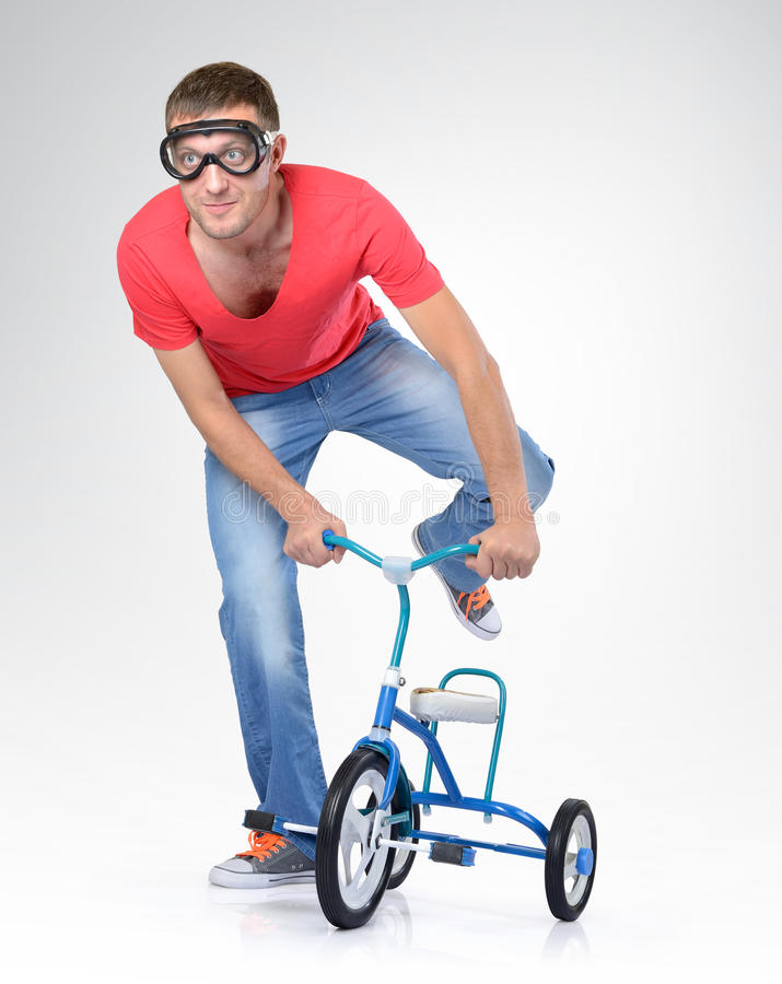 Download Man On A Children's Bicycle Royalty Free Stock Photography - Image: 27568867