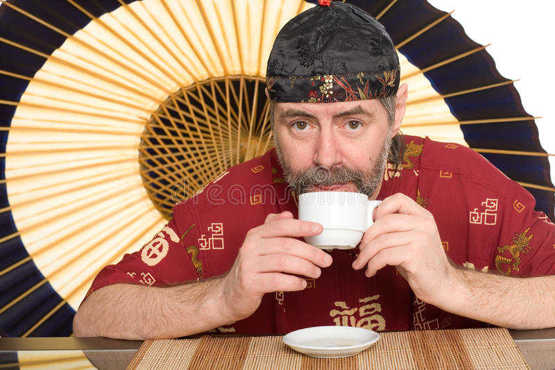 Man in chinese costume drinking tea royalty free stock images