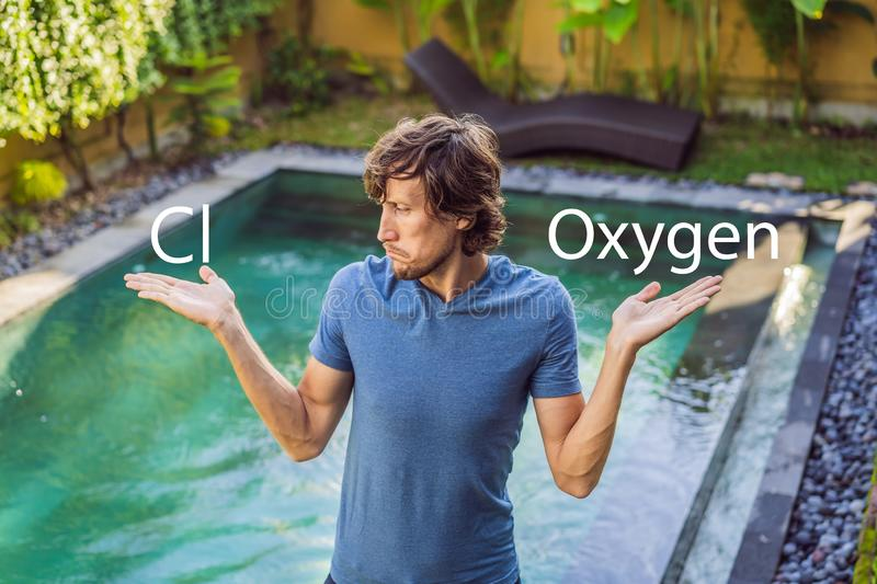 Man chooses chemicals for the pool chlorine or oxygen. Swimming pool service and equipment with chemical cleaning. Products and tools stock photography