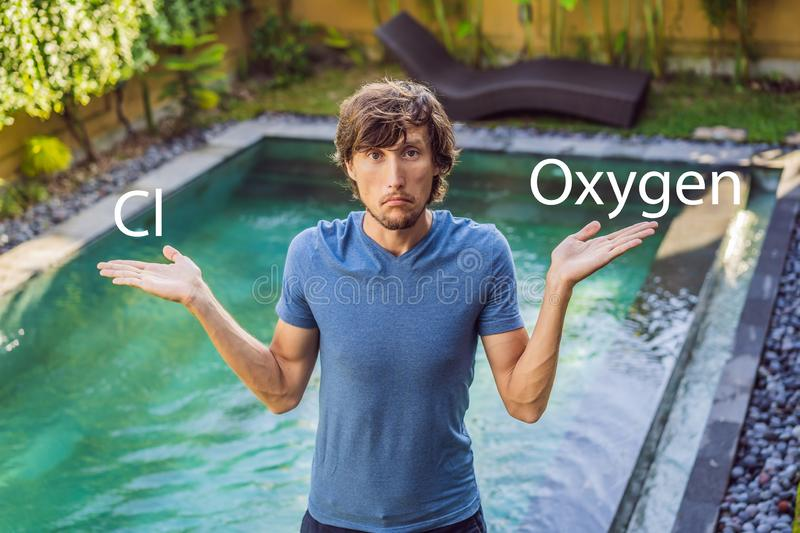 Man chooses chemicals for the pool chlorine or oxygen. Swimming pool service and equipment with chemical cleaning. Products and tools stock photo