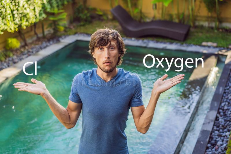 Man chooses chemicals for the pool chlorine or oxygen. Swimming pool service and equipment with chemical cleaning. Products and tools royalty free stock images
