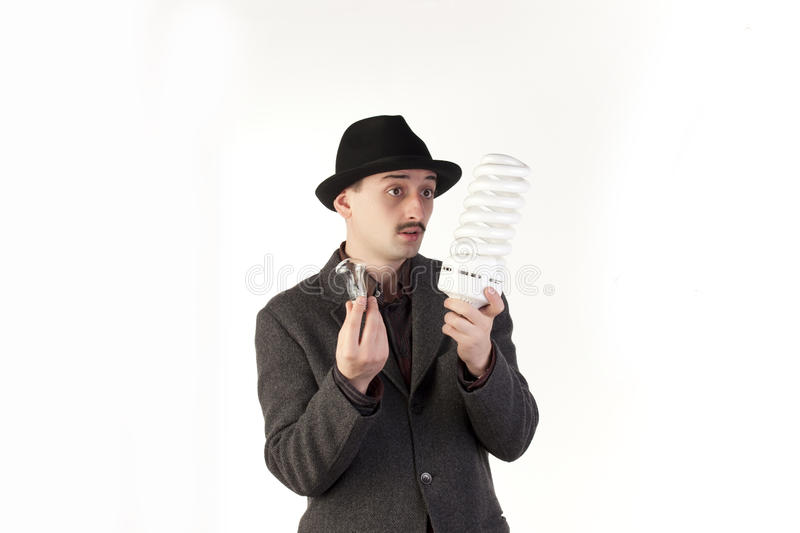 Download Man choosing a bulb stock photo. Image of mature, isolated - 12332634