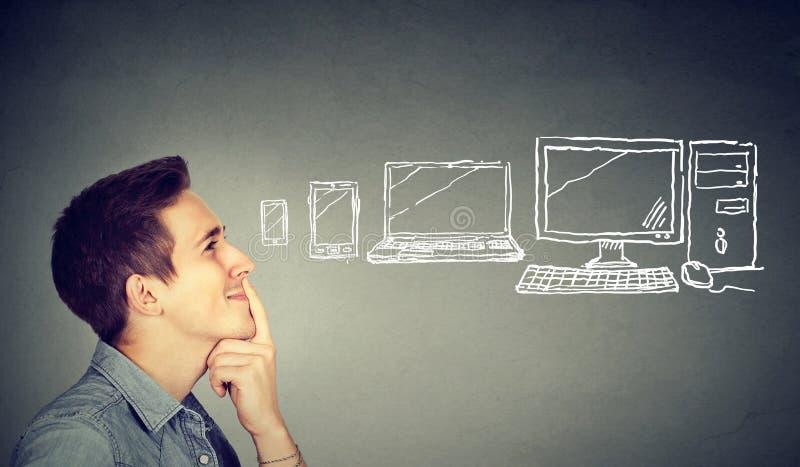 Man choosing a communication gadget stock photos