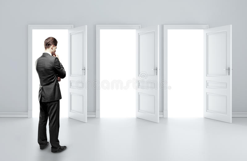 Man choosing door stock photography