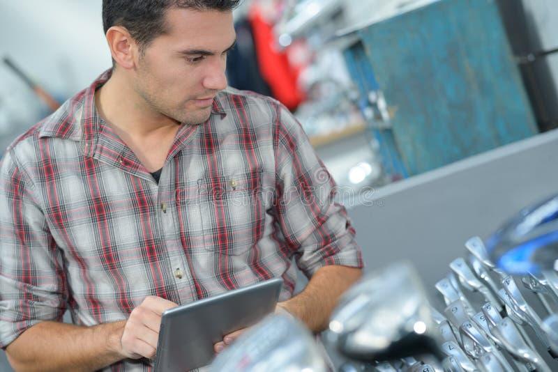 Man choosing metallic tap in household store stock photos