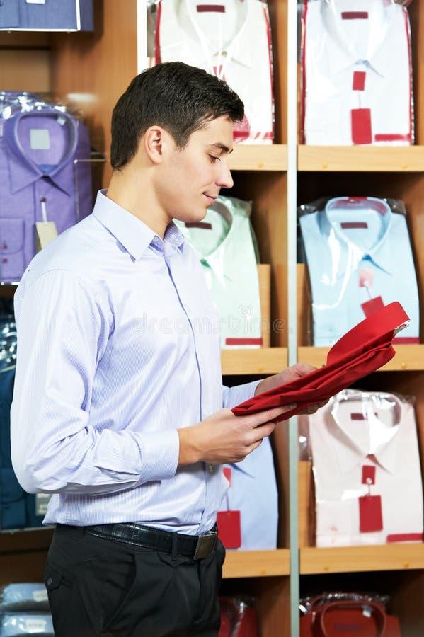 Man shopping clothes. choosing shirt royalty free stock images