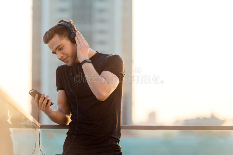 Man choosing song for running stock image