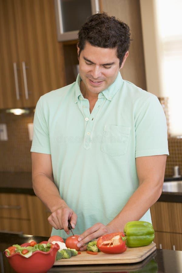 Man Chopping Vegetables stock photo