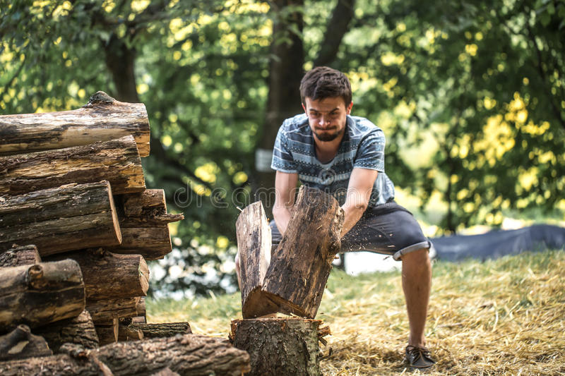 Image result for man chopping wood