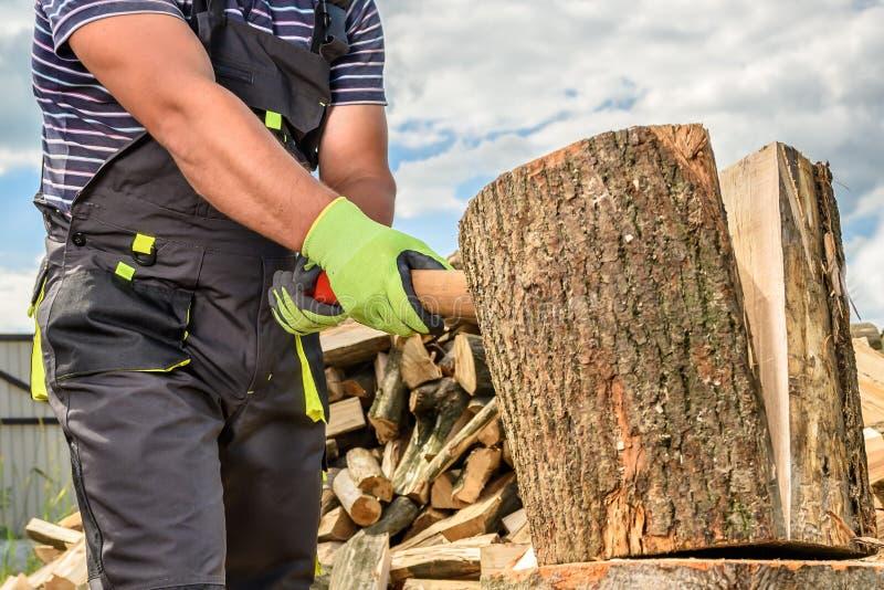 Man chopping wood royalty free stock photography