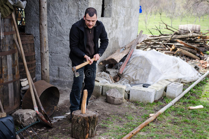 Man chopping wood royalty free stock images