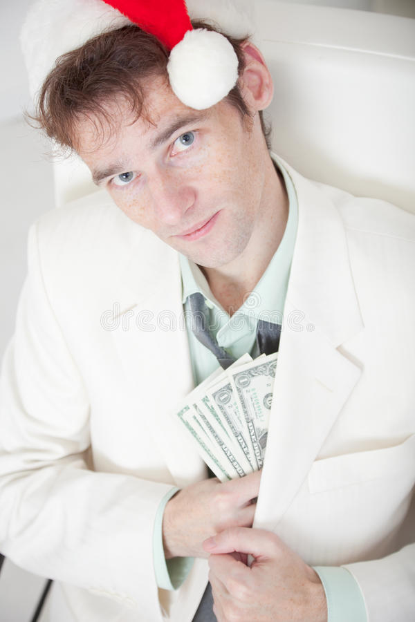 Download Man In Christmas Cap Hides Money In Pocke Stock Image - Image: 11593137