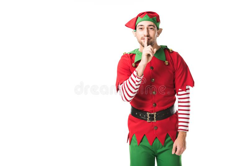 man in christmas elf costume showing hush silence sign and looking at camera isolated royalty free stock photos