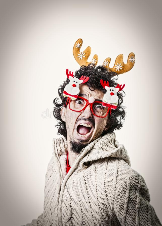 Man with christmas glasses and dreadful face stock photos