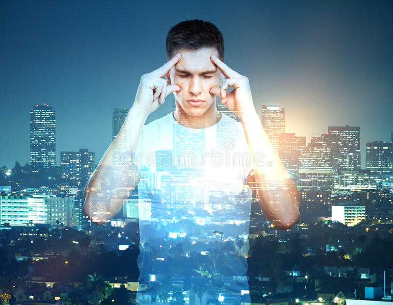 Man on city background multiexposure. Thoughtful caucasian man on night city background. Research concept. Double exposure stock photography