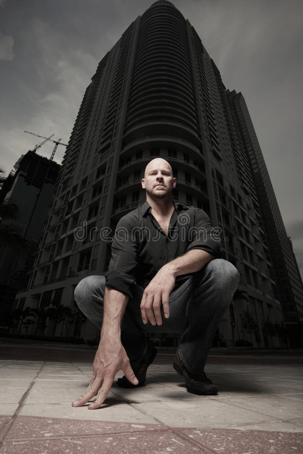 Man in the city at night. Man standing in the city at night stock photography