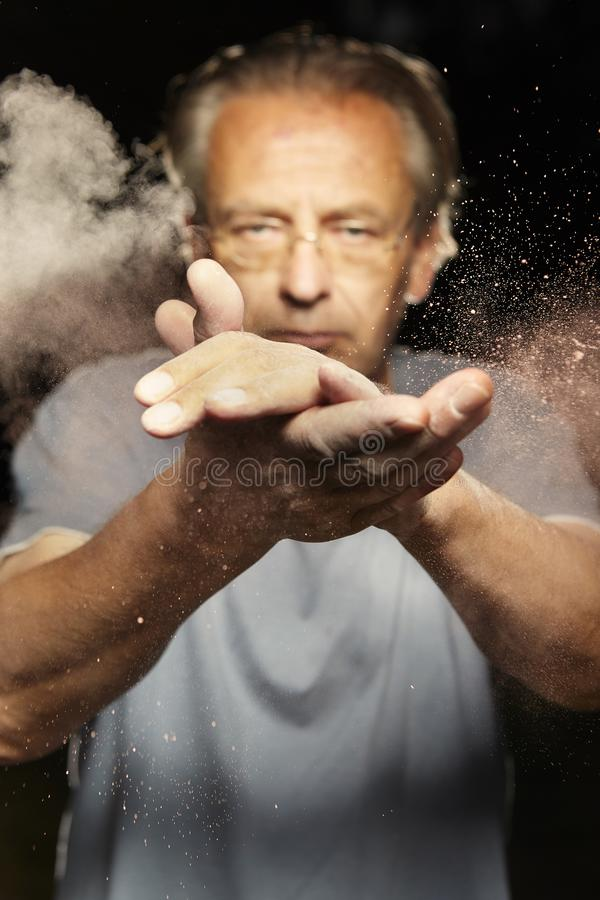 Particles of dust, dirt and flour moving fast after hands clapping royalty free stock images