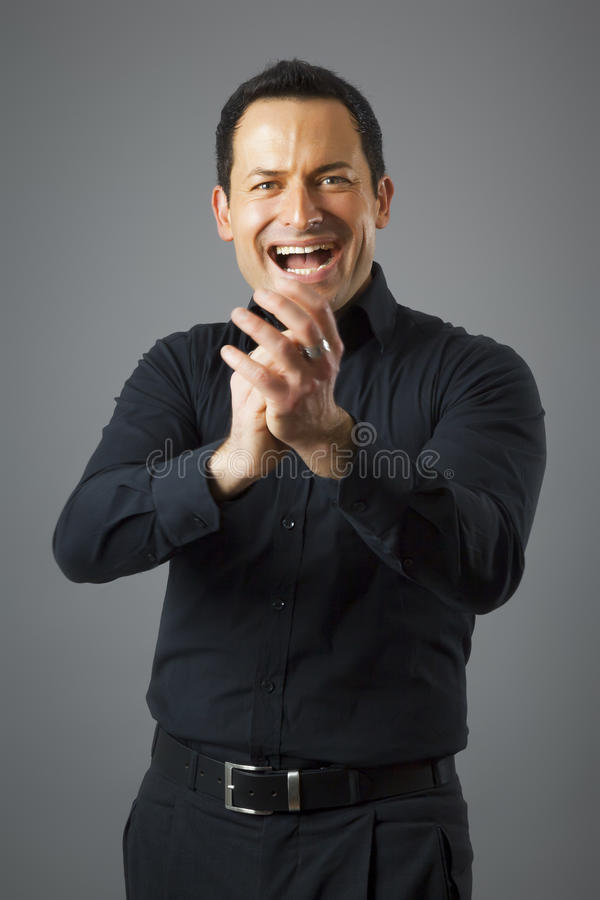 Man claps his hands stock photo