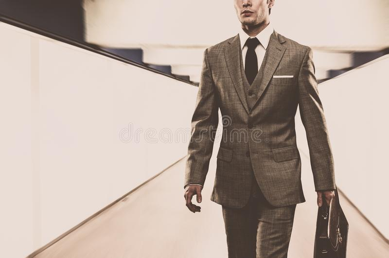 Businessman walking stock image