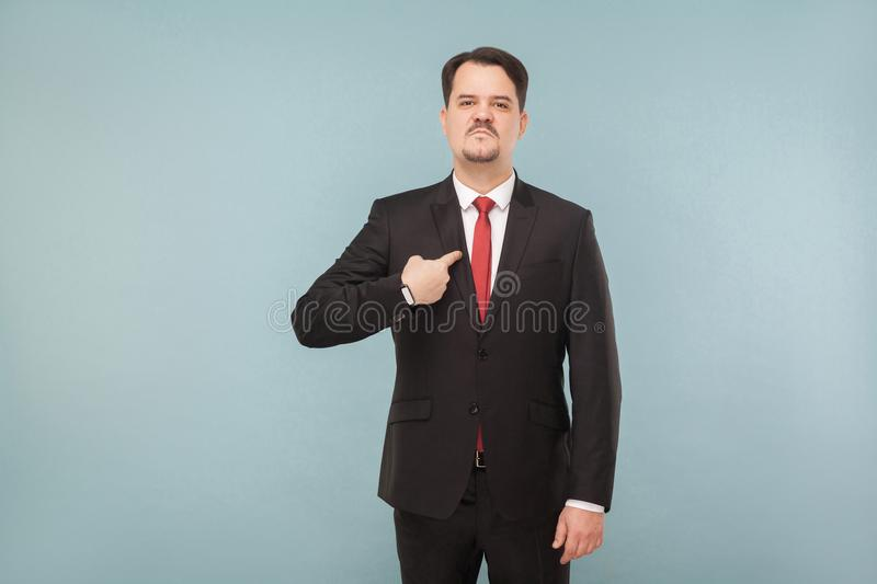 Man in classic wear pointing himself at camera royalty free stock images
