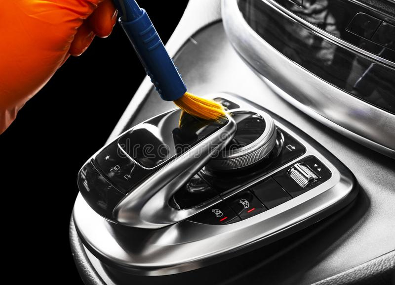 A man cleaning car with brush. Car detailing or valeting concept. Selective focus. Car detailing. Cleaning with sponge. Worker cle. Aning. Car wash concept stock image