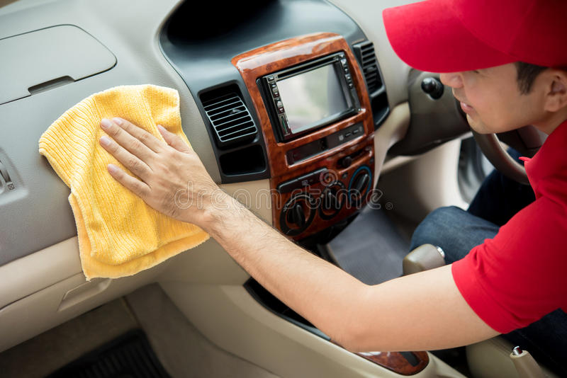 A man cleaning car interior. Car detailing and valeting concept stock photos