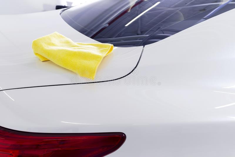 A man cleaning car with microfiber cloth. Car detailing or valeting concept. Selective focus. Car detailing. Cleaning with sponge. Worker cleaning. Car wash stock photo