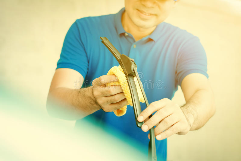A man cleaning car windscreen windshield wiper royalty free stock photo
